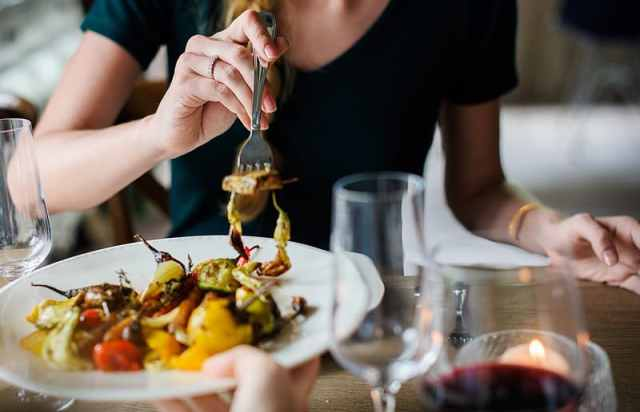 photo-of-woman-wearing-black-top-holding-fork-with-cooked-vegetable
